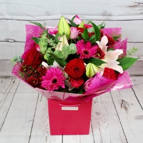 raspberry-love-romantic-handtie-bouquet-red-cerise-pink-lilies-red-roses-delivered-strood-rochester-medway